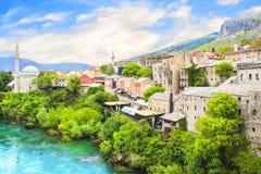 Beautiful view of the Karadjozbegov mosque jamia on the banks of the Neretva River in Mostar, Bosnia and Herzegovina Royalty Free Stock Image