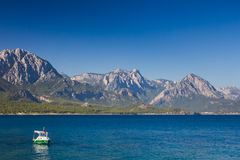 Beautiful view of Kemer town and boat in the sea Stock Photography