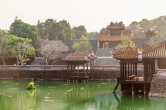 Beautiful view of the Tu Duc Royal Tomb, Hue, Vietnam. Beautiful view of Khiem Cung Gate, Du Khiem Pavilion and Xung Khiem Pavilion by Luu Khiem Lake at the Tu stock photo