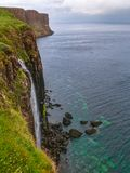 Spectacular waterfall into the sea stock image