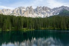 Beautiful view of Lago di Carezza with mountain reflections in the water, Italy stock photos