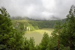 Beautiful Crater Lake. Beautiful view of Lagoa do Canario on a dramatic summer day in the Azores stock image