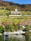 Beautiful view from lake biel to the vineyards with a church royalty free stock photo