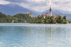 Beautiful view of Lake Bled with Island, Church And Castle With Mountain Range Stol, Vrtaca, Begunjscica In The Background- Bled Stock Photos