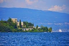 Beautiful view of Isola Garda in Garda Lake Italy. Beautiful view of Lake Garda with Island of Garda at the foreground.Northern Italy.sola del Garda or Isola di stock image