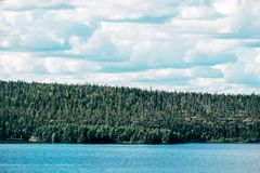 Beautiful view of the lake with green coast Royalty Free Stock Image