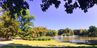 Beautiful view of lake in the park with fountains Stock Image