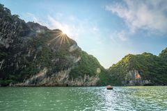 Beautiful landscape of Halong Bay with sunshine over the limestone mountain in Vietnam. Beautiful view landscape of Halong Bay with sunshine over the limestone stock photo