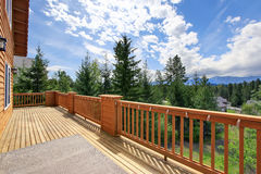 Beautiful view large wooden balcony in cabin style home. Beautiful view from balcony from cabin style home in the woods stock images
