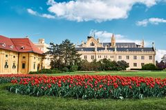 Beautiful view of lednice castle with storm clouds and blooming stock photo