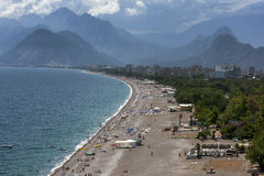 A beautiful view looking down the beach at Konyaalti Plaji in Antalya in Turkey. Royalty Free Stock Images