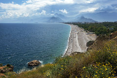 A beautiful view looking down the beach at Konyaalti Plaji in Antalya in Turkey. Royalty Free Stock Photos