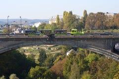 Beautiful view of Luxembourg city bridge. Beautiful cityscape view of Luxembourg city bridge with tourist train in autumn morning Stock Photos