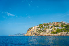 Beautiful view of Mallorca balearic islands, with some buildings in the mountain, in a beautiful blue sky Spain.  Royalty Free Stock Photos