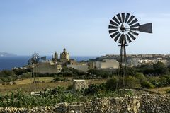 Beautiful view of maltese coast in the clear sunny day, sea, beautiful houses and windmills. On a background the sea. Beautiful view of maltese coast in clear Royalty Free Stock Photography