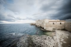 Beautiful view of Maniace castle in Ortigia Syracuse, in front of the sea and sky. Horizontal view royalty free stock image