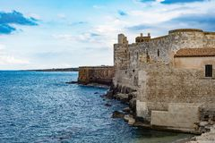 Beautiful view of Maniace castle in Ortigia Syracuse, in front of the sea and sky. Horizontal view stock photo