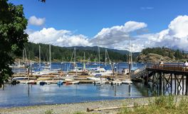 A beautiful view of the marina full of boats on a beautiful summer day in Heriot Bay, on Quadra Island, Desolation Sound. British Columbia, Canada stock images