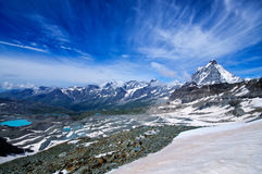 Beautiful view of Matterhorn. Alpine landscape with peaks, clouds, snow and lakes Stock Image