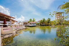 Beautiful view of Memories Caribe resort grounds, buildings and tropical garden Royalty Free Stock Image