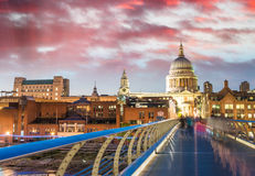 Beautiful view of Millennium Bridge and St Paul Cathedral at dus Royalty Free Stock Image