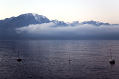 Beautiful view by a misty morning at sunrise on Lake Geneva Stock Photo