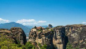 Beautiful view of the monastery of the Holy Trinity and its surrounding mountains in the region of Meteora, Greece stock photo