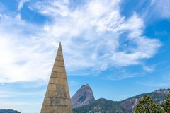 Beautiful panoramic view of the Sugar Loaf mountain in Rio de Janeiro, Brazil, on a beautiful and relaxing sunny day with blue sky royalty free stock image