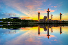 Beautiful view of mosque by the lakeside with full reflection Stock Photo