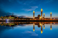 Beautiful view of mosque by the lakeside with full reflection Royalty Free Stock Images