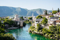 Beautiful view on Mostar city with old bridge, mosque and ancient buildings on Neretva river Royalty Free Stock Images