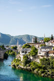 Beautiful view on Mostar city with old bridge, mosque and ancient buildings on Neretva river Stock Photography