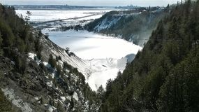 Beautiful view from a mountain on the St. Lawrence River next to Quebec City in Canada. Beautiful view from a mountain on the icy St. Lawrence River near Quebec royalty free stock images