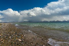 A beautiful view of the mountain lake. Son-Kul with delightful clouds and blue sky Stock Photo