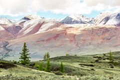Beautiful view of the mountain range with snow-capped peaks. Landscape of mountain valleys and cliffs stock photos