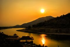 Beautiful view of a mountain river at sunset at Kanchanaburi , thailand. Beautiful view of a mountain river at sunset at Kanchanaburi , thailand Royalty Free Stock Photos