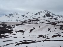 Beautiful view of the mountains in the area of Elbrus. Panorama overlooking the top of the mountain covered with snow stock photos