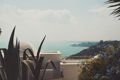 Beautiful view of the mountains and bay on terrace. balcony with flowers Royalty Free Stock Photos