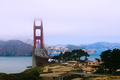 Beautiful view of the mountains and the bridge, the top of which is hidden in the fog stock images