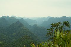 Beautiful view mountains in haze in Halong Bay in Vietnam. On the top of mountain on the island in Halong Bay in Vietnam. beautiful view  blue mountains in haze Stock Photos