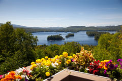 Beautiful view on the mountains lake from balcony with yellow an Royalty Free Stock Photo