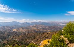 Beautiful view of the mountains in the region of Andalusia, houses and farmland on the slopes of mountains. Nature stock image