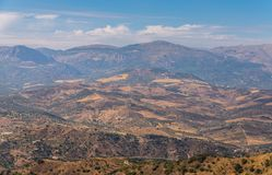 Beautiful view of the mountains in the region of Andalusia, houses and farmland on the slopes of mountains. Nature royalty free stock image