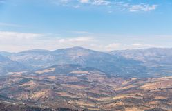 Beautiful view of the mountains in the region of Andalusia, houses and farmland on the slopes of mountains. Nature royalty free stock photos