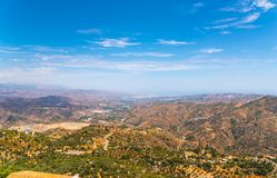 Beautiful view of the mountains in the region of Andalusia, houses and farmland on the slopes of mountains. Nature stock photography