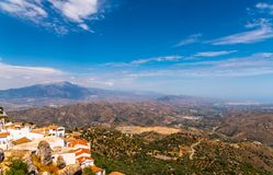Beautiful view of the mountains in the region of Andalusia, houses and farmland on the slopes of mountains. Nature stock photos