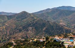 Beautiful view of the mountains in the region of Andalusia, houses and farmland on the slopes of mountains. Nature stock images