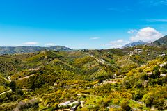 Beautiful view of the mountains in the region of Andalusia, houses and farmland on the slopes of mountains. Nature royalty free stock images