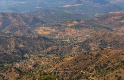 Beautiful view of the mountains in the region of Andalusia, houses and farmland on the slopes of mountains. Nature stock photo