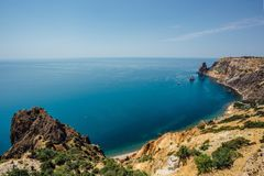 Beautiful view of the mountains and rocky coast of the azure Black sea, Cape Fiolent, Crimea Royalty Free Stock Images